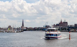 ROSTOCK, GERMANY - CIRCA 2016: Many tour boats provide transportation from the Warnemunde cruise port to the old town of Rostock i. N Germany Stock Photography