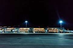 ROSTOV-ON-DON, RUSSIA - 28 APRIL 2018: Jet bridges in Platov airport in evening. ROSTOV-ON-DON, RUSSIA - 28 APRIL 2018: Evening view of gates and jet bridges at Royalty Free Stock Photos