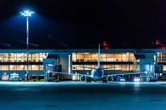 ROSTOV-ON-DON, RUSSIA - 28 APRIL 2018: Jet bridges in Platov airport in evening. ROSTOV-ON-DON, RUSSIA - 28 APRIL 2018: Evening view of gates and jet bridges at Royalty Free Stock Photo