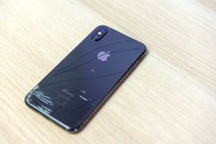 ROSTOV-ON-DON, RUSSIA - DECEMBER 20, 2018: iPhone Ten X with broken display. Modern smartphone with damaged glass screen. Device. Needs repair stock photos