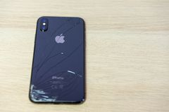 ROSTOV-ON-DON, RUSSIA - DECEMBER 20, 2018: iPhone Ten X with broken display. Modern smartphone with damaged glass screen. Device. Needs repair royalty free stock image