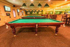 ROSTOV-ON-DON, RUSSIA - FEBRUARY 2, 2018: Billiard room interior with tables. Playing pool is popular sport in Russia Royalty Free Stock Photography