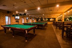 ROSTOV-ON-DON, RUSSIA - FEBRUARY 2, 2018: Billiard room interior with tables. Playing pool is popular sport in Russia Stock Images