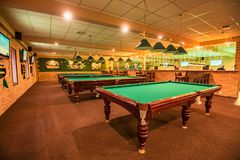 ROSTOV-ON-DON, RUSSIA - FEBRUARY 2, 2018: Billiard room interior with tables. Playing pool is popular sport in Russia Royalty Free Stock Images