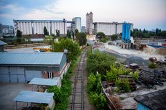 Industrial zone of a city with grain elevator and railway royalty free stock photos