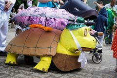 ROSTOV-ON-DON, RUSSIA - 20 May, 2018. Festival Ball of Babies. A parade of Stroller. Stroller dressed in a turtle costume stock images
