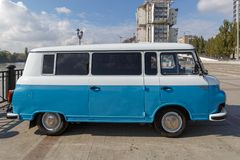 Cyan retro minivan Barkas B1000 at the show of old cars on embankment of Don river. Side view. ROSTOV-ON-DON, RUSSIA, 07 OCTOBER 2017: Cyan retro minivan Barkas royalty free stock images