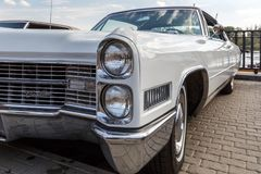 Rare car Cadillac Coupe de Ville in white colour at the exhibition of retro cars. Front view. ROSTOV-ON-DON, RUSSIA, 07 OCTOBER 2017: Rare car Cadillac Coupe de stock images
