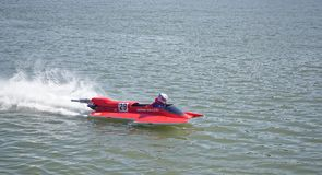 Racer on the speed boat rushes in front of the audience at the Royalty Free Stock Photos