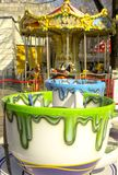 Rostov-on-don, Russian Federation, March 30 2019. Amusement park. Attraction in the form of white mugs drenched with green and blu stock photo
