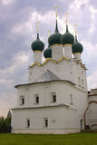 Rostov the Great Church of St. Gregory the theologian Kremlin. Rostov the Great Church of St. Gregory the theologian clouds Golden cross Kremlin dome arch lawn Royalty Free Stock Image
