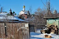 Poor and modest courtyard in Rostov the Great, Russia. Rostov the Great on a winter sunny day, cityscape of the old Russian city Royalty Free Stock Images