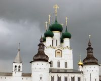 Rostov Kremlin . White church against the dark stormy sky. Russia. Rostov. June, 17, 2017. Rostov Kremlin that is located in Rostov city . White kremlin walls Stock Photography