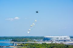 ROSTOV-NA-DONU, RUSSIA - CIRCA SEPTEMBER 2017: Russian paratroopers in sky at military air parade. ROSTOV-NA-DONU, RUSSIA - CIRCA SEPTEMBER 2017: Russian stock image