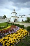Rostov Veliky Kremlin Holy gates flowerbed Golden cross Stock Image