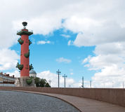 Rostral column in clouds. Famous Rostral column at St.Petersburg, Russia Stock Photography