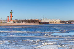 Rostral columns and floating ice on Neva river in Petersburg Royalty Free Stock Photo