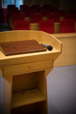 Rostrum with a microphone in a reference room Royalty Free Stock Photo