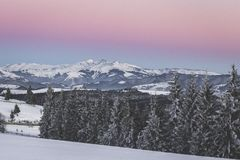 Rodnei Mountains. Rosu, Ineut and Ineu from right to left peaks viewed from Tihuta Pass, along with the Belt of Venus and Earth`s shadow Stock Photography