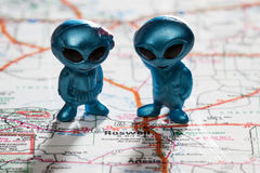 Roswell New Mexico. Toy ETs standing on a Map of New Mexico right above the city of Roswell royalty free stock image