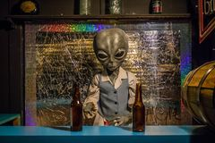 A miniature models of UFO in Roswell, New Mexico. Roswell, NM, USA - April 21, 2018: The famous international collections of UFO model inside the museum stock images