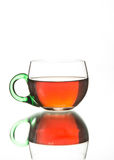 Rosy black tea in a glass teacup Stock Images