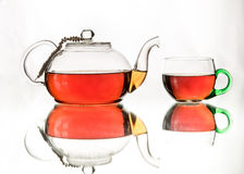 Rosy black tea in glass teapot and teacup Royalty Free Stock Photography