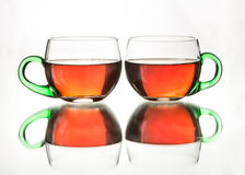 Rosy black tea in  a pair of glass teacups Stock Photography
