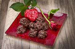 Rosy and chocolate heart in the Valentinsday Royalty Free Stock Photos