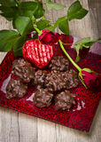 Rosy and chocolate heart in the Valentinsday Stock Image