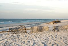 Rosy Dawn at Florida Beach with Sand Fences royalty free stock photo