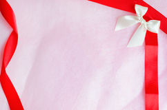 Rosy pink paper background with ribbon and bow Stock Photography