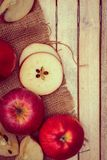 Rosy Red Apples. On burlap sack cloth royalty free stock image