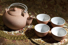 Rosy set for tea. Rosy ceramic tea set - teapot and 4 cups Stock Photo