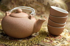 Rosy set for tea. Rosy ceramic tea set - teapot and 4 cups Stock Photography