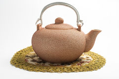 Rosy set for tea. Rosy ceramic tea pot on serviette Royalty Free Stock Images