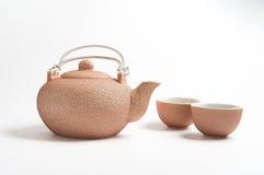 Rosy set for tea. Rosy ceramic tea set on white background Royalty Free Stock Photography
