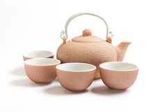 Rosy set for tea. Rosy ceramic tea set on white background Royalty Free Stock Photos