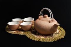 Rosy set for tea. Rosy ceramic tea set on serviettes Royalty Free Stock Photography