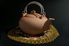 Rosy teapot. Rosy ceramic teapot on serviette Royalty Free Stock Images