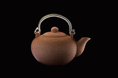 Rosy teapot. Rosy ceramic teapot on black background Stock Images
