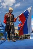 Rosyjski kozaczek z Rosyjską flaga Zdjęcie Royalty Free
