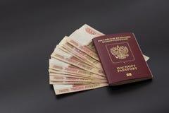 Rosyjski paszport i paczka pięć thousandth rubli banknotów Cudzoziemski paszport w czerwonym rosjanina pieniądze i pokrywie obrazy royalty free