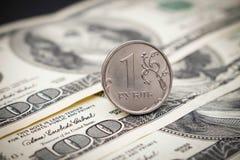 Rosyjski rubel na tle sto dolarów Obrazy Stock