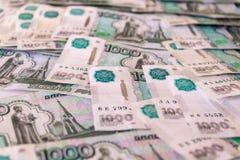 Rosyjski rubel, pieniądze, banknoty w wyznaniach 1000 Rosyjscy pieni?dzy banknoty, t?o, tekstura fotografia stock