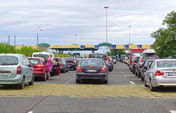 Roszke Hungary. ROSZKE, HUNGARY - JULY 09, 2015: Long lines at border crossing in Roszke, Hungary. Traffic jam at customs checkpoint between Serbia and Hungary Royalty Free Stock Images