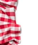Rot gefaltete Tischdecke lokalisiert Lizenzfreie Stockfotografie