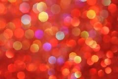 Rot, gelb, Türkis, purpurrotes abstraktes bokeh - perfektes Weihnachten und Valentinsgrußhintergrund Lizenzfreie Stockbilder