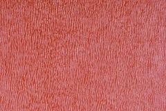 Rot prägte dekorativen Kunstlederbeschaffenheitshintergrund, Abschluss oben Stockbilder