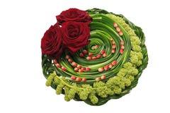 Rot stieg in einen Blumenstrauß Lizenzfreie Stockfotografie